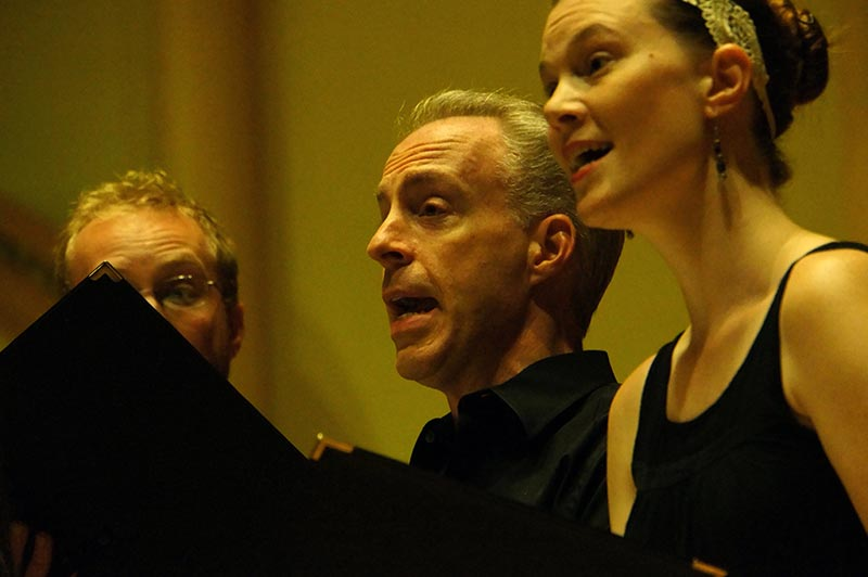 Images of Musica Sacra choral singers performing in concert.